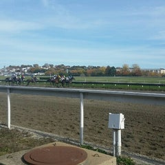 Photo taken at Suffolk Downs by Erica N. on 10/31/2015