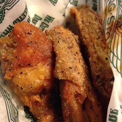 Photo taken at Wingstop by Derick T. on 5/22/2014