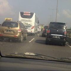 Photo taken at Jalan Tol Ir. Wiyoto Wiyono, M.Sc. by Rhiandra I. on 6/20/2014