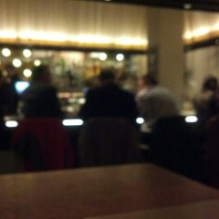 Photo taken at Ella Dining Room & Bar by Courtney C. on 11/30/2012