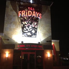 Photo taken at TGI Fridays by Erika G. on 10/23/2012