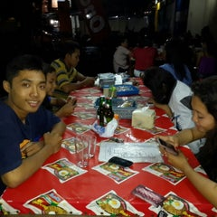 Photo taken at Warung Nasi Gandul & Wedang Punokawan by Ebby P. on 12/23/2013
