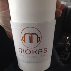 Photo taken at Mokas Coffee by Mallory S. on 3/11/2014