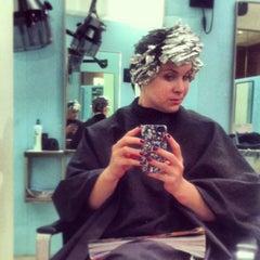 Photo taken at Mario Tricoci Hair Salon & Day Spa by Nic on 12/21/2012