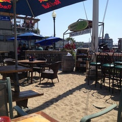 Photo taken at Sand Bar & Grille by Mike P. on 6/21/2013