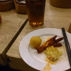 Photo taken at Bamboo Dimsum by Miho Y. on 3/22/2014