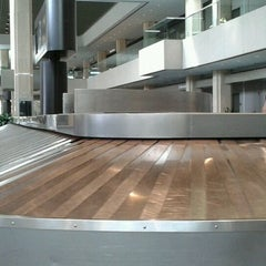Photo taken at Baggage Claim by Lisa E. on 3/20/2013