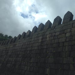 Photo taken at Muralhas da Cidade de Guimarães by João Filipe S. on 4/24/2014