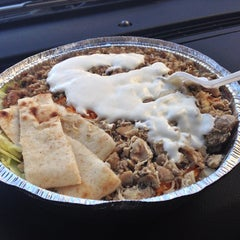 Photo taken at The Halal Guys by Julian F. on 11/14/2012