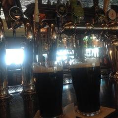 Photo taken at Tigín Irish Pub & Reataurant by Elena S. on 3/23/2015