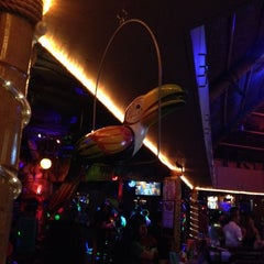 Photo taken at Toucans Tiki Lounge by LuisFer S. on 4/18/2014