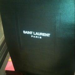 Photo taken at Yves Saint Laurent by Panthep L. on 2/23/2013