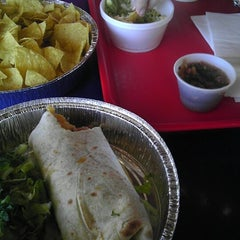 Photo taken at Cafe Rio Mexican Grill by Martin A. on 4/15/2013