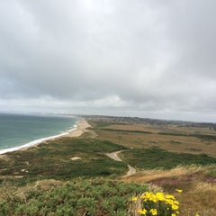 Photo taken at Hengistbury Head by Milene R. on 7/17/2015
