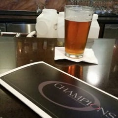 Photo taken at Champions Sports Bar by Gina G. on 12/31/2014