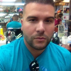 Photo taken at Carl's Barber Shop by Carlos G. on 9/15/2013