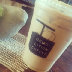 Photo taken at Demolition Coffee by Vanessa S. on 7/3/2015
