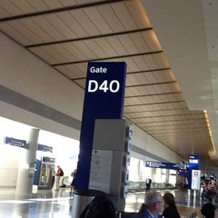 Photo taken at Gate D40 by Cinthia D. on 12/13/2012