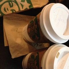 Photo taken at Starbucks by Cinthia D. on 2/2/2014