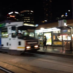 Photo taken at Tram Stop 13 - Federation Square (3/3a, 5, 6, 16, 64, 67, 72) by Eric A. on 1/29/2014