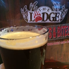 Photo taken at The Lodge Beer and Growler Bar by Julia H. on 5/17/2015