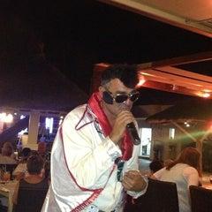 Photo taken at Ideal Beach Hotel Restaurant Pool Bar by Nikos D. on 9/15/2013