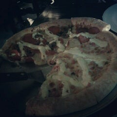 Photo taken at Super Pizza Pan by Amanda C. on 1/6/2013