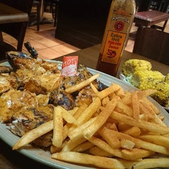 Photo taken at Nando's by D C. on 8/10/2014