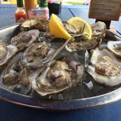 Photo taken at The Conch Grill & Raw Bar by Marlon A. on 4/18/2015