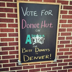 Photo taken at The Donut Hut Cafe by Aaron W. on 7/20/2014