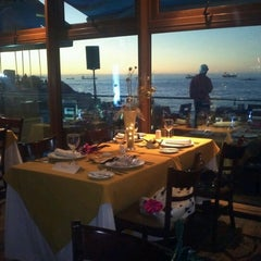 Photo taken at Restaurant Tierra de Fuego by Carmen V. on 1/1/2013