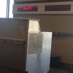 Photo taken at Gate F8 by Adrienne W. on 10/27/2012