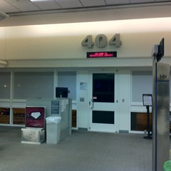 Photo taken at Gate 404 by Bryce H. on 12/18/2012
