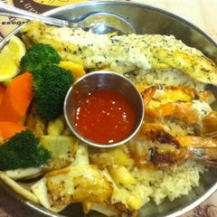 Photo taken at The Manhattan Fish Market by Nur Hafizah on 10/30/2012