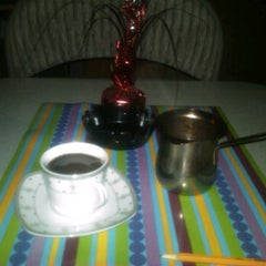 Photo taken at Ali Mama's Cafe by Enrique C. on 9/3/2011