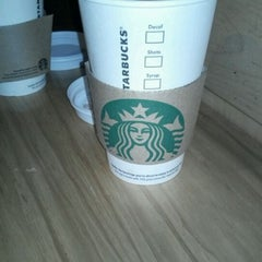 Photo taken at Starbucks by Bruno O. on 2/19/2012