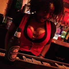 Photo taken at Coyote Ugly Saloon by Ravin D. on 8/9/2012
