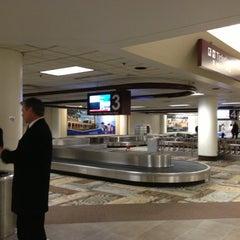 Photo taken at Baggage Claim by Sam P. on 10/16/2012