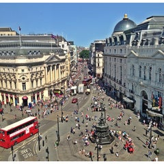 Photo taken at Piccadilly Circus by Pawel Z. on 7/9/2013