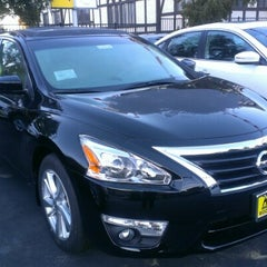 Photo taken at Woodland Hills Nissan by Dino C. on 1/5/2013