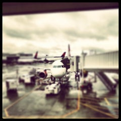 Photo taken at Gate A4 by Chad S. on 4/10/2013