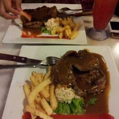 Photo taken at Umi's  Steak & Cafe by Yusry Y. on 10/24/2012