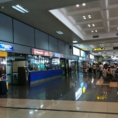 Photo taken at Noi Bai International Airport (HAN) Sân bay Quốc tế Nội Bài by Tung T. on 10/21/2012