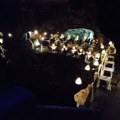 Photo taken at Grotta Palazzese by Okan B. on 10/17/2015