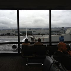 Photo taken at United International Check In by Chris B. on 11/29/2012