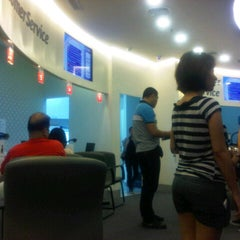 Photo taken at Globe Telecom by vale p. on 10/31/2012