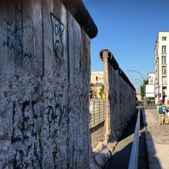 Photo taken at Baudenkmal Berliner Mauer   Berlin Wall Monument by Daryn on 5/16/2013