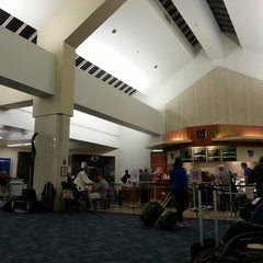 Photo taken at Gate 47 by Maite M. on 7/20/2013