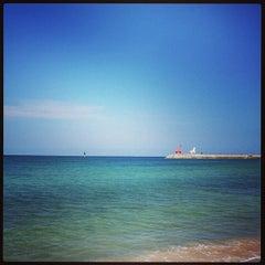 Photo taken at 이호테우해변 (Iho Taewu Beach) by Dongkwang K. on 9/9/2013