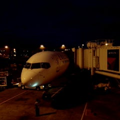 Photo taken at Gate A26 by Christiaan K. on 4/30/2014
